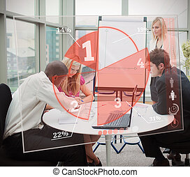 Business people using red pie chart interface in...