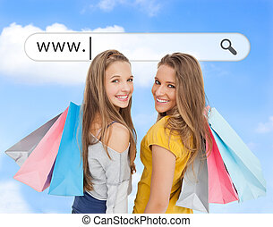 Smiling girls with their shopping bags under address bar on...