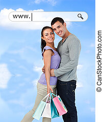 Happy couple with their shopping bags under address bar on...
