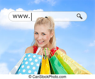 Happy blonde with her shopping bags under address bar on...