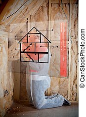 Man insulating walls following instructions on interface -...
