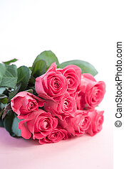 Bouquet of pink roses on a light pink table