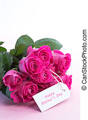 Bouquet of pink roses with happy mothers day card on a table...