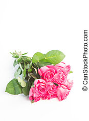 Bouquet of pink roses on a white table