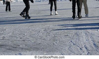 people skate lake winter