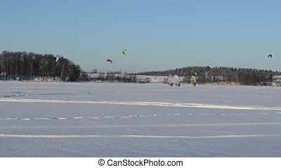 ice surfing kiteboarding - three people ice surfing sailing...