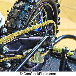 motorcycle wheel and drive-chain