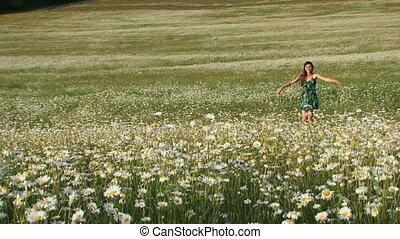 Summer in a village - Joyful woman among blooming daisies