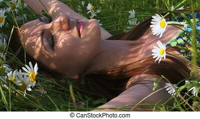 Beautiful woman among chamomiles - Beautiful woman resting...
