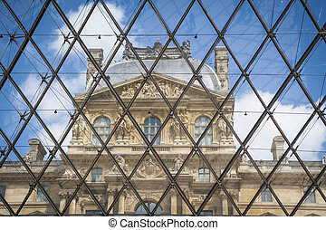 Louvre Palace building seen through pyramid