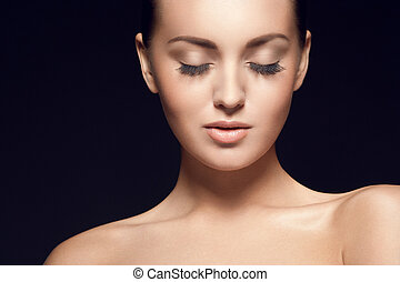 portrait of beautiful young model, with eyes closed -...