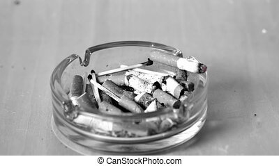 Cigarette falling in ashtray in slow motion