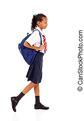 female elementary school student walking on white
