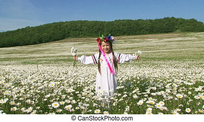 Child in a chamomile meadow