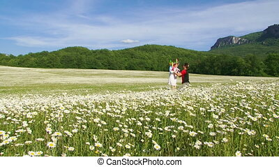 Family fun - Father and daughter in a chamomile meadow