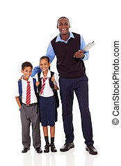 elementary school teacher and students full length portrait...