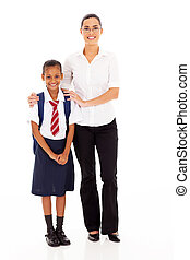 elementary schoolgirl and teacher full length portrait on...