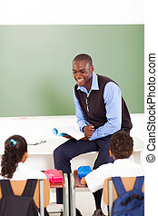 male african primary school teacher teaching in classroom
