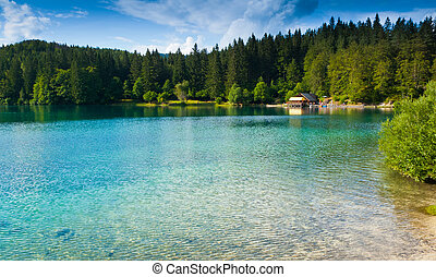 Fusine Lower Lake - View of lower lake and hut in Fusine,...