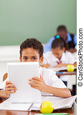 elementary school student using tablet - cute male...