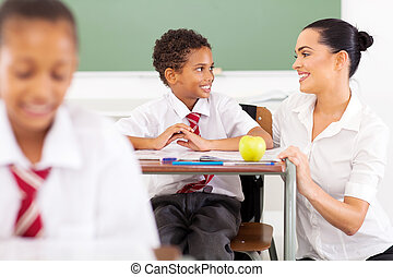 school teacher talking to a student - caring elementary...