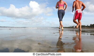 Joggers  - Two joggers training together at beach