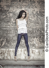 Beautiful young latina woman wearing denim jeans standing...