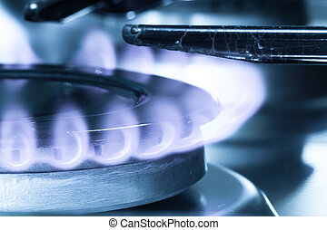Flames of gas stove close-up shot Natural gas