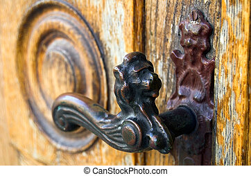 ancient times - The ancient handle on an ancient door