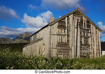 Old wooden house - Old deteriorated wooden farm house in...