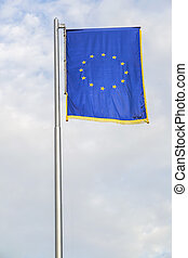 European Union Flag With Cloudy Sky As Background