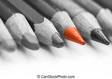 Standing Out Of The Crowd - Closeup Of An Orange Crayon...