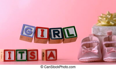 Its a girl message in letter blocks in slow motion