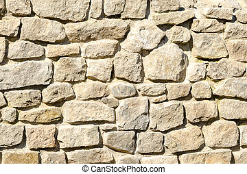 Texture of a wall made of crushed rocks