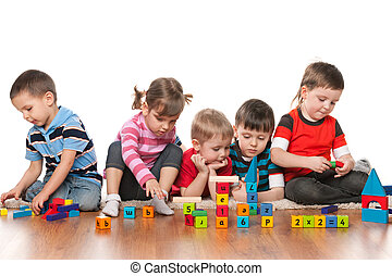 Five kids playing on the floor