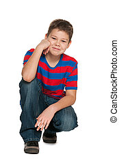 Handsome boy in striped shirt - A smiling handsome boy in...
