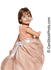 Smiling little girl in a ball gown - A smiling little girl...