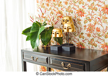 Side table with flowers and interior decoration next to...