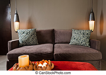 Brown two seated sofa dark ambience
