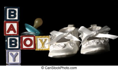 Baby shoes falling besides baby blo