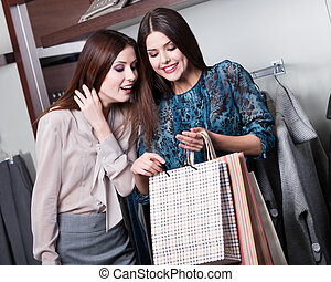 Two friends buy gifts with a rebate