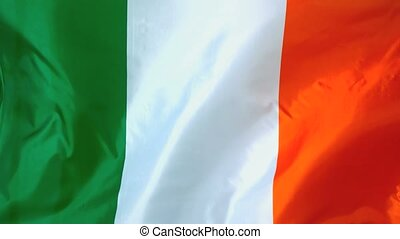 Irish flag waving in the wind in slow motion
