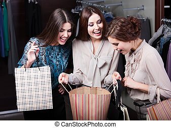 Girls wonder the purchases of their girlfriend - Two girls...