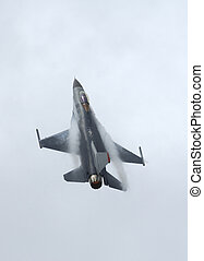 F-16 in airshow - F-16 Fighter Falcon in vertical climb -...