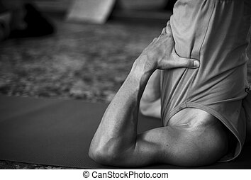 male arms doing yoga