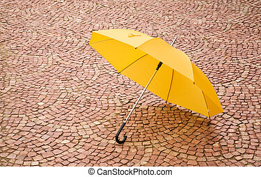 yellow umbrella - season concept, special toned focus point...
