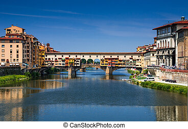 Ponte Vecchio over Arno river, Florence, Tuscany in Italy -...