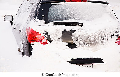 car after snowfall - urban winter concept (focus point on...