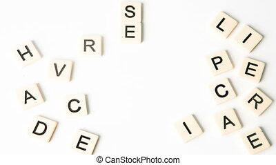 Customer care buzz words formed into crossword shape in stop...