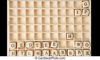 Business buzz words spelled out in dice and placed on grid...